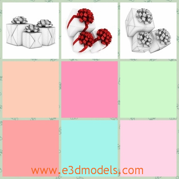 3d model of Christmas gifts - This is a 3d model which is about three Christmas gifts wrapped in white papers and tied by red ribbons.