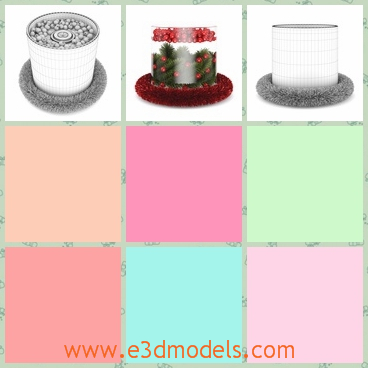 3d model of a cylindrical Christmas decoration - There is a 3d model which is about Christmas table decoration. There we can see a cylindrical thing in which there are green leaves.
