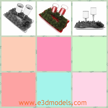 3d model of two Christmas candles - There is a 3d model which is about two Christmas candles which are set on small red piece with green plants round it.