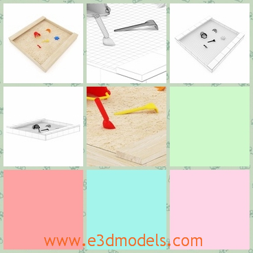 3d model of a wooden sandpit - There is a 3d model which is about a wooden sandpit. In this sandpit we can see thin brown sand and a red plastic shovel.
